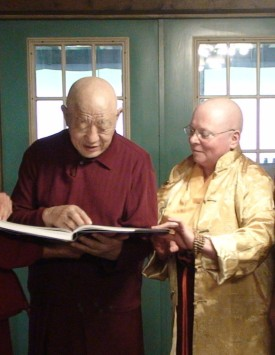Showing the Treasure Book to a monk at a Tibetan Monastery in New York